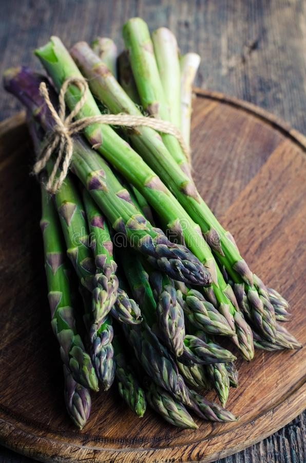 Bunch of asparagus on wooden board stock image