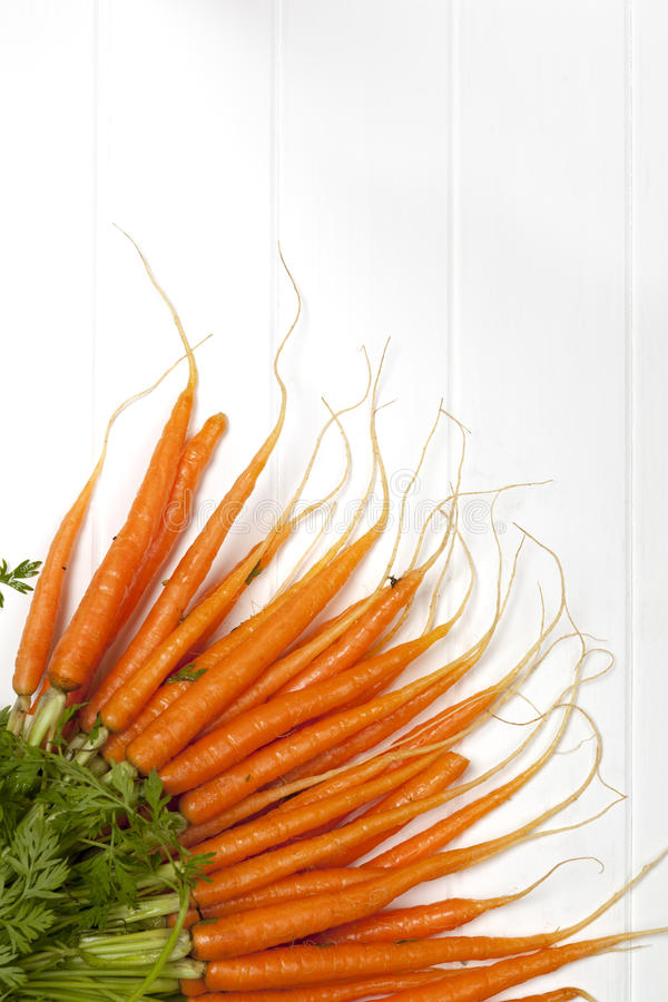Download Bunch Of Baby Carrots Over White Timber Royalty Free Stock Photo - Image: 30859095