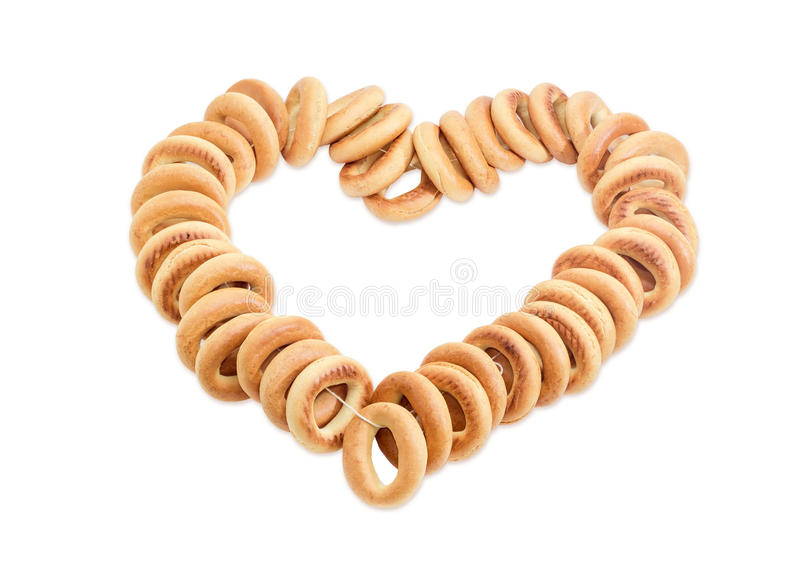 Bunch of bagels laid out in the form of heart stock photos