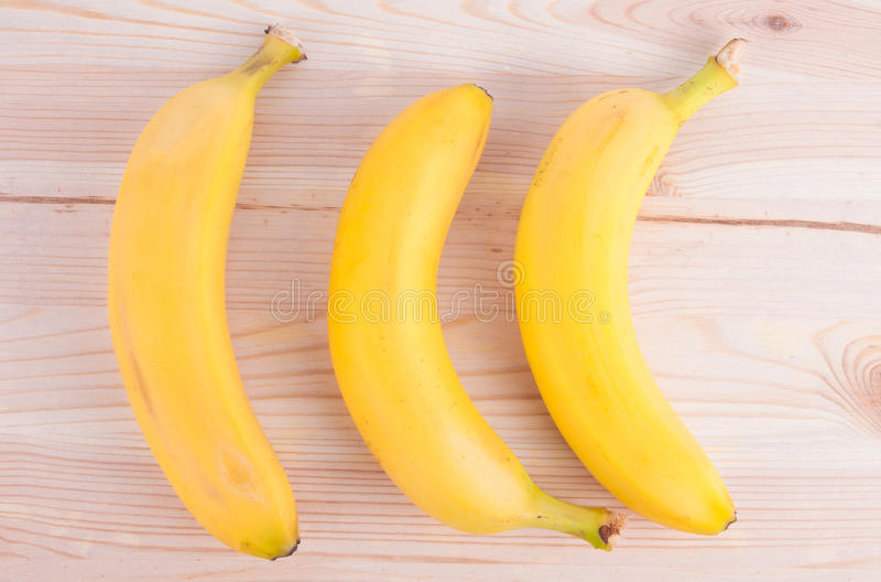 Bunch of bananas on rustic wooden table stock photo