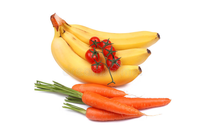 Bunch of bananas, tomatoes and carrot royalty free stock photo