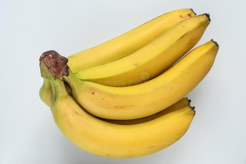 Bunch of bananas on white background. Healthy vegetarian nutrition. Tropical fruit. Exotic summer diet. royalty free stock photos