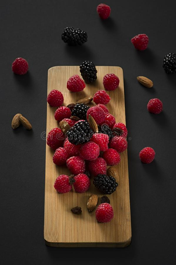 Bunch of berries scattered against wooden board royalty free stock photo