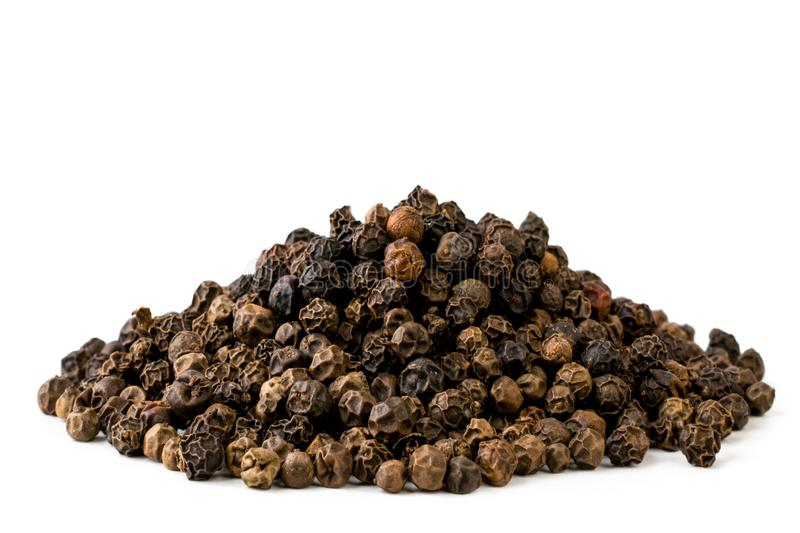 A bunch of black pepper closeup on a white. Isolated stock photo