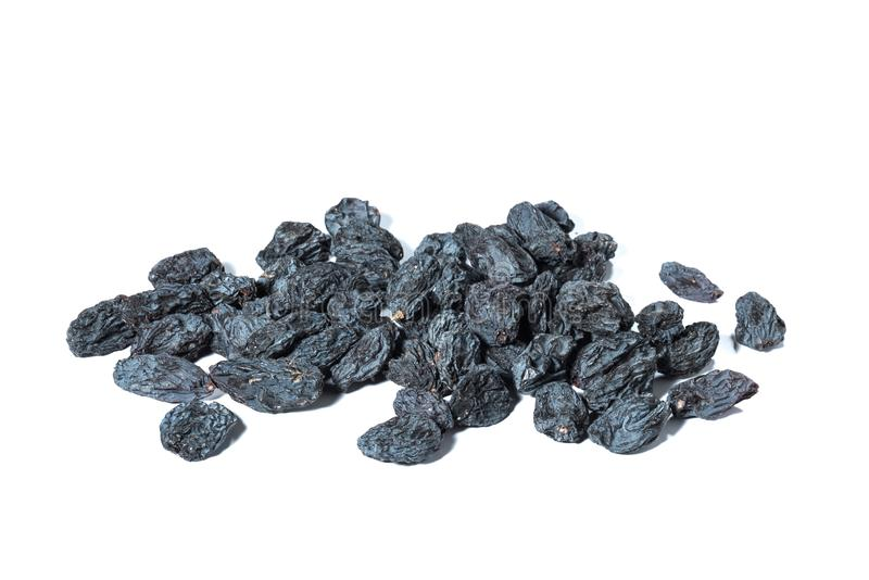 A bunch of black raisins on a white background. royalty free stock image