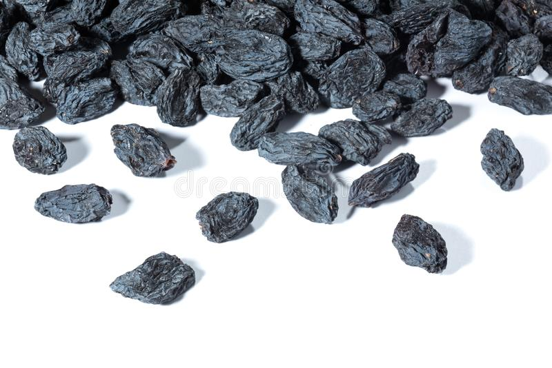 A bunch of black raisins on a white background. royalty free stock photo