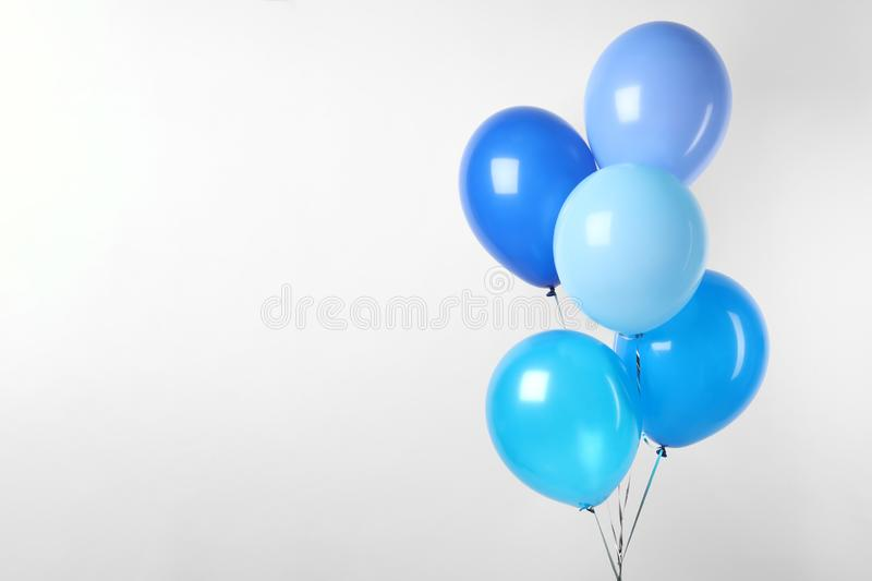 Bunch of blue balloons on white. Greeting card. Bunch of blue balloons on white background. Greeting card stock photography