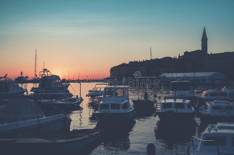 Bunch of Boats on Body of Water during Golden Hour royalty free stock photo