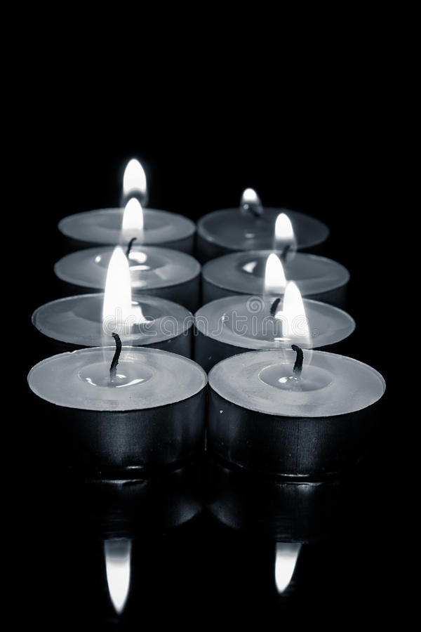 Row of candles, in black and white photograph. Bunch of candles, in black and white photograph, with shallow depth of field stock photos