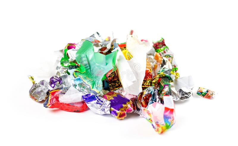 A bunch of candy wrappers on a white background. Closeup stock photo