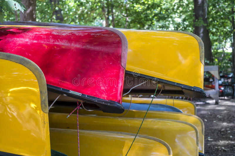 Bunch of canoes. Bunch of colorful canoes ready for rent stock photography