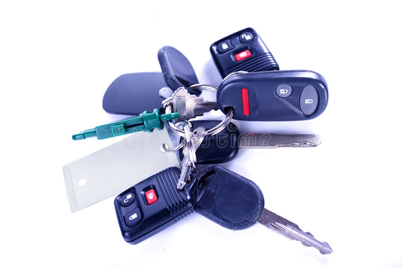 Bunch of car keys and openers. Bunch of car keys with remote openers stock images