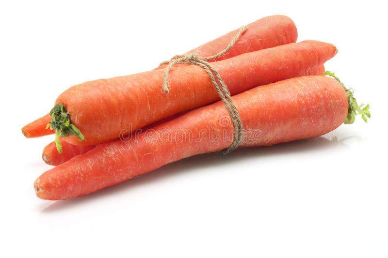 Bunch of Carrots. On White Background royalty free stock image