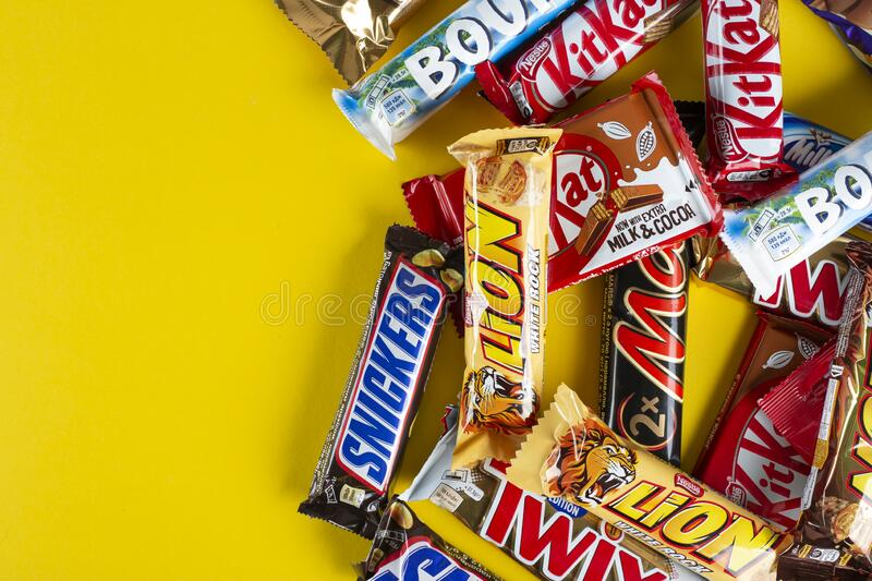 Snickers Chocolate Bar On Yellow