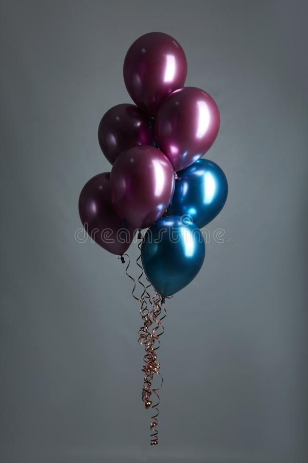 Bunch of color balloons on grey. Background stock photo