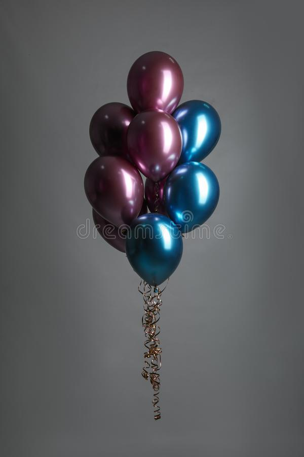 Bunch of color balloons. On grey background stock photos