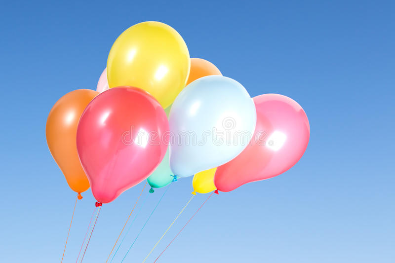 Bunch of colorful balloons in the blue sky royalty free stock photo