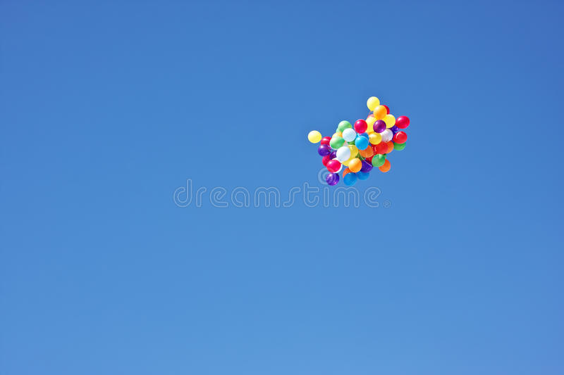 Bunch of colorful helium balloons. Rising into the sky. celebratory background stock images