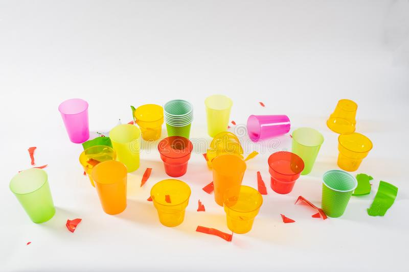 Bunch of colorful plastic cups being broken and thrown stock photography