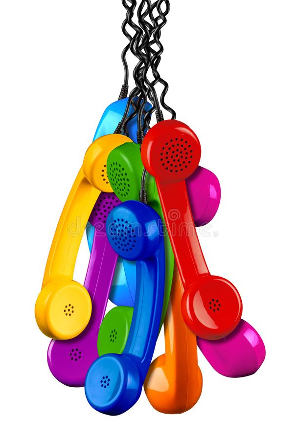 Bunch of colorful rainbow colored old fashioned retro phone reciever with black telephone wire isolated white background, business royalty free stock photo