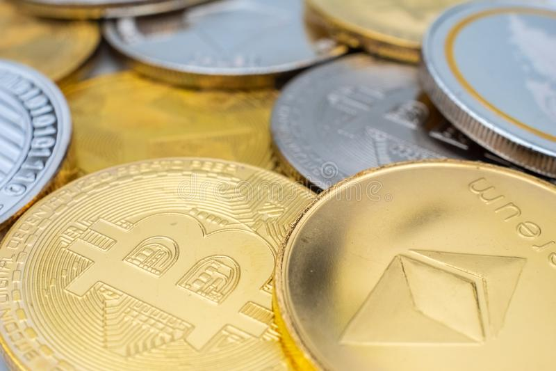 Bunch of Crypto currency coins with focus on BTC Bitcoin and ETH Ethereum. Bunch of Crypto currency coins with various of shiny silver and golden physical royalty free stock photo