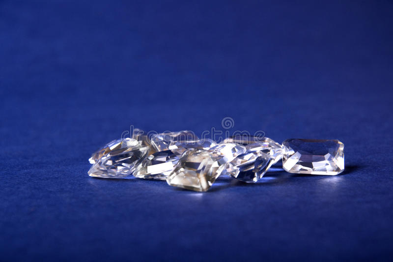 A bunch of crystals on a blue background royalty free stock photos
