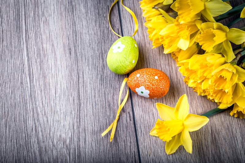 Bunch of daffodils with easter eggs for Easter royalty free stock images