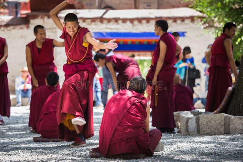 A bunch of debating Tibetan Buddhist monks at Sera Monastery stock photography