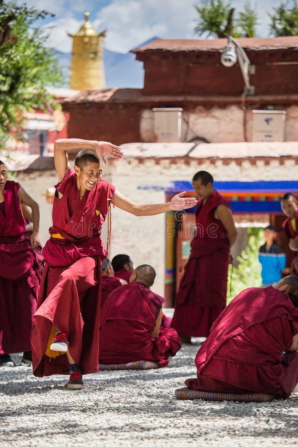 A bunch of debating Tibetan Buddhist monks at Sera Monastery. This event is a famous activity at Sera Monastery in Lhasa, Tibet. A group of Lama are separated royalty free stock photo