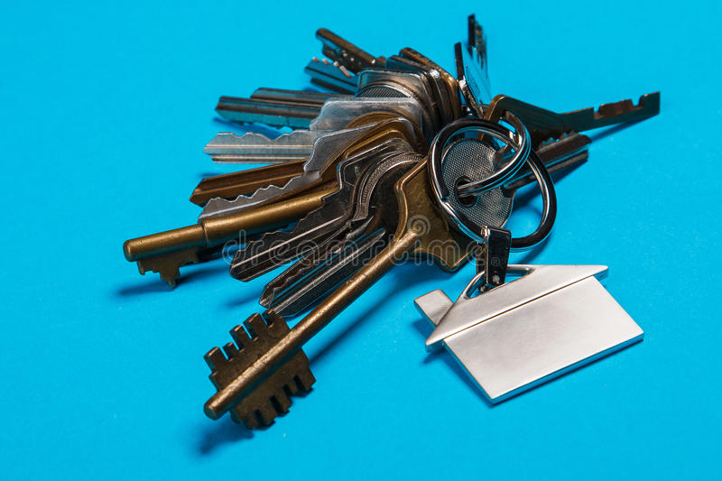 Bunch of different keys. On blue background stock photography