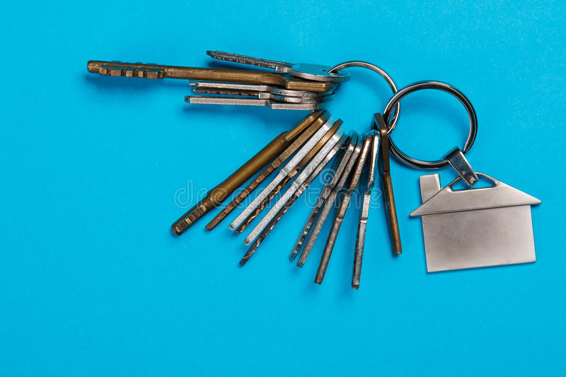 Bunch of different keys. On blue background royalty free stock images