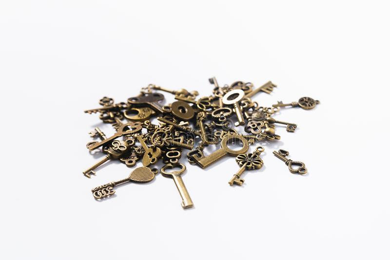 Bunch of different keys on a white background royalty free stock photography