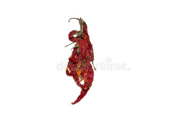 Bunch of dry hot red chili peppers isolated on a white background stock photos