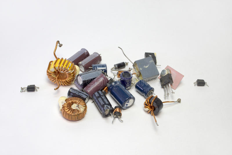 Bunch of electronic parts: capacitors, transistors, inductors royalty free stock image
