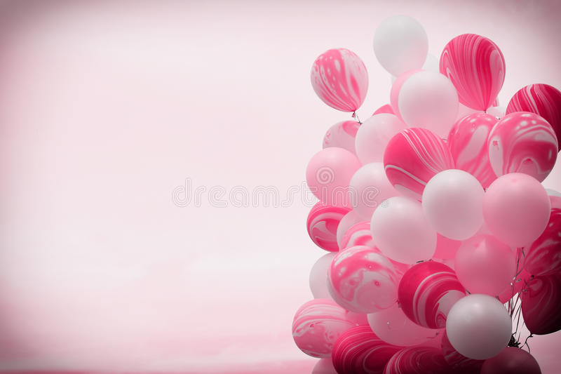 Bunch of fancy pink color balloons floating away in to the sky with vintage filter background royalty free stock photos