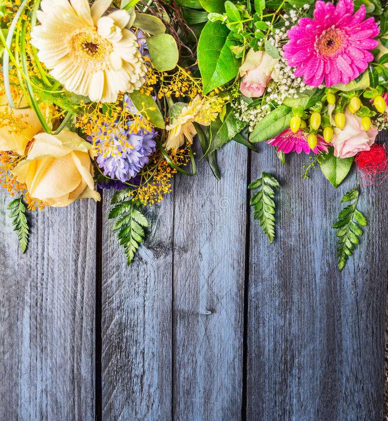 Bunch of flowers on blue wooden background, top view royalty free stock photo