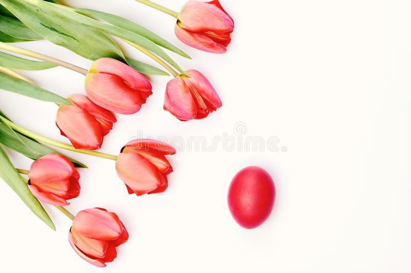 Bunch of flowers near Easter egg. Bouquet of spring tulips stock photography