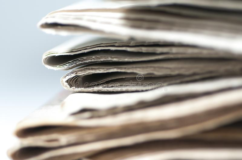 A bunch of folded newspaper close up shot. stock photos