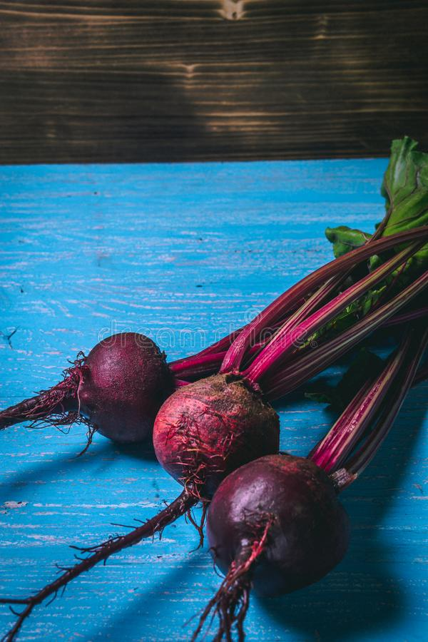 A bunch of fresh beets on old blue wooden table. Copy space. Healthy food. Raw Vegetables royalty free stock photo