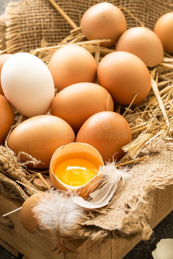 Bunch of fresh brown eggs in a wooden crate. stock photos