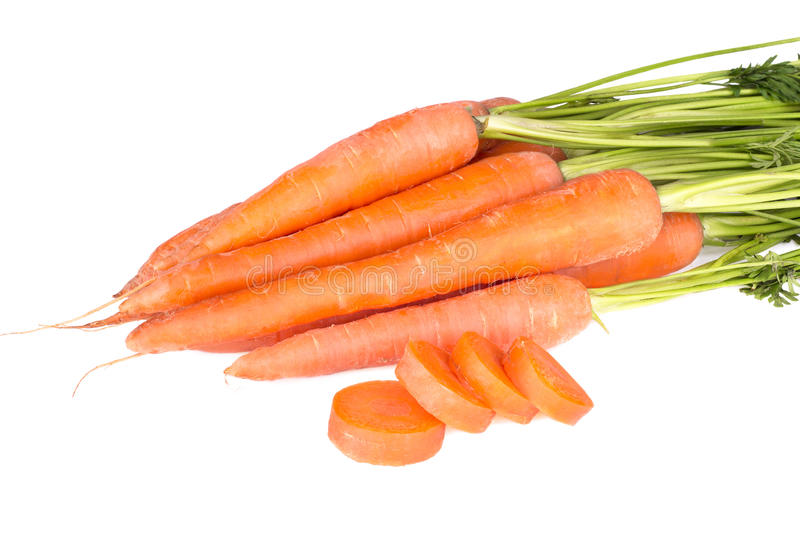 Bunch of fresh carrots isolated on a white stock image