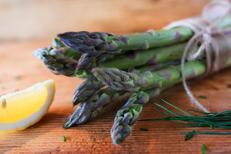 Bunch of fresh green asparagus with lemon stock photography