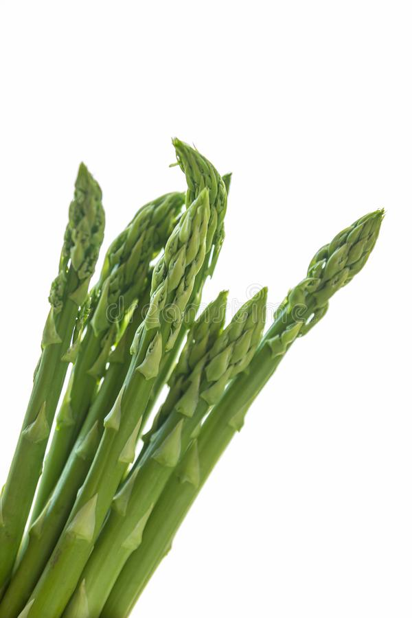 Bunch of fresh green asparagus on white background stock photo
