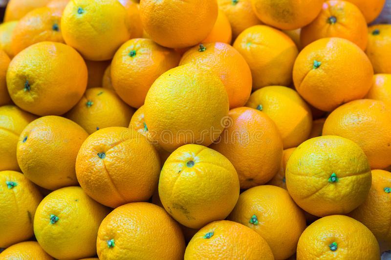 Bunch of fresh oranges for retail sale at an outdoor market. Bunch of fresh oranges for retail sale at an outdoor market stock image