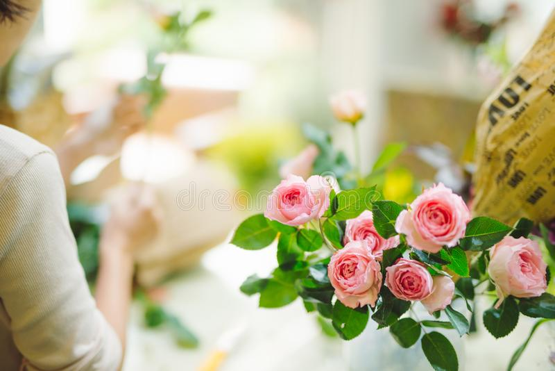 Bunch of fresh pink roses at flower shop royalty free stock photography