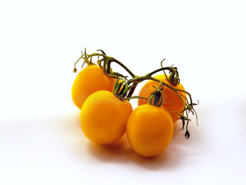 Bunch of fresh yellow tomatoes isolated on white background. Close up royalty free stock images