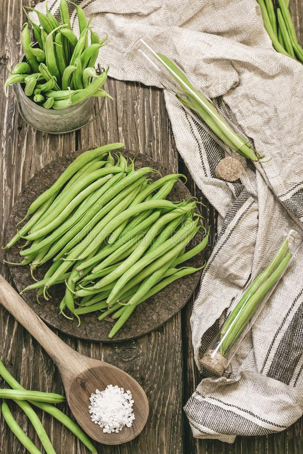 Bunch of freshly picked green beans on a rustic wooden surface. stock photos