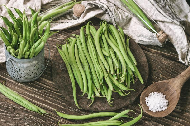 Bunch of freshly picked green beans on a rustic wooden surface. royalty free stock images
