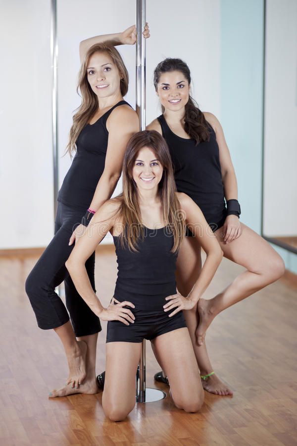 Bunch of girls loving pole fitness royalty free stock photography