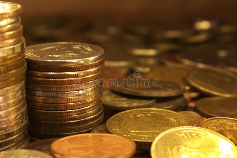 A bunch of golden metallic coins royalty free stock photos